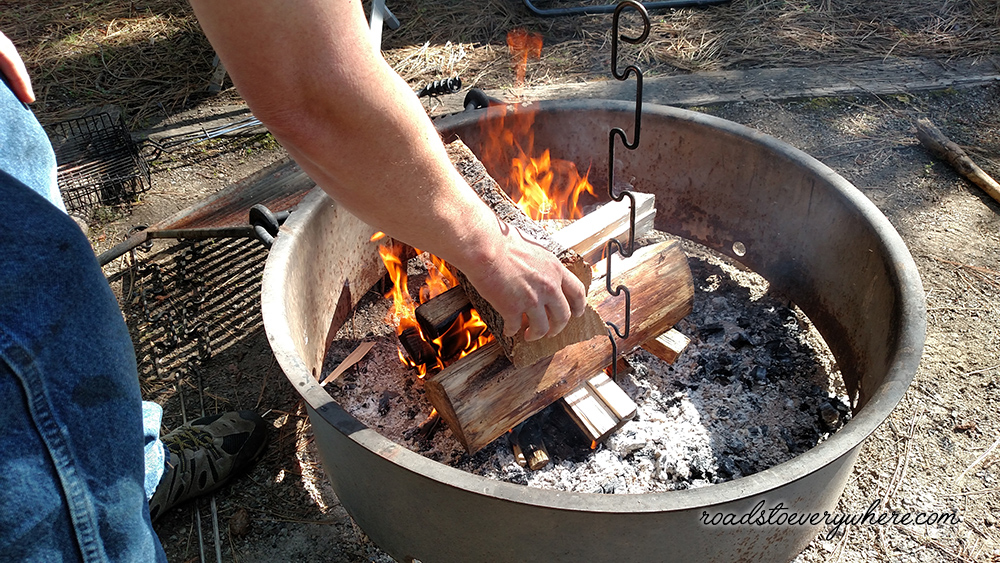 adding wood to the fire